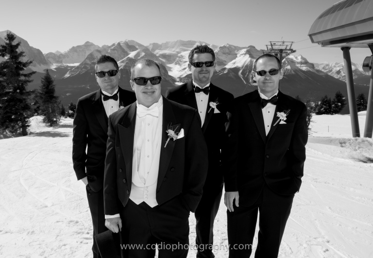 top of mountain wedding groomsmen