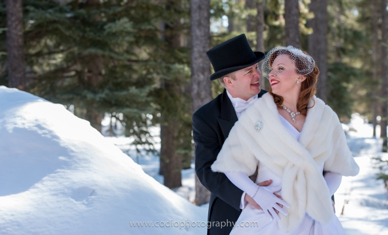 top hat and veil wedding couple