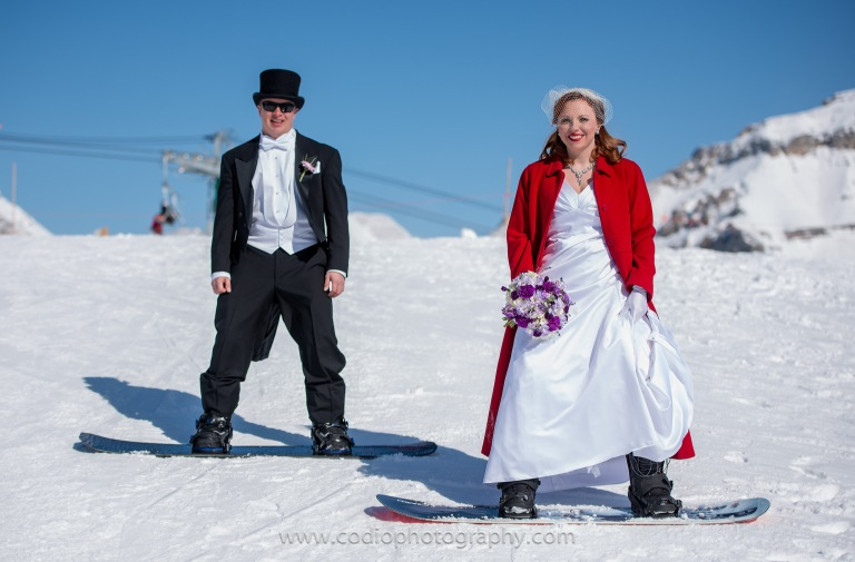 wedding couple snowboarding