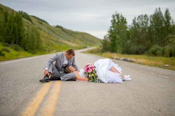 bride and groom laying down