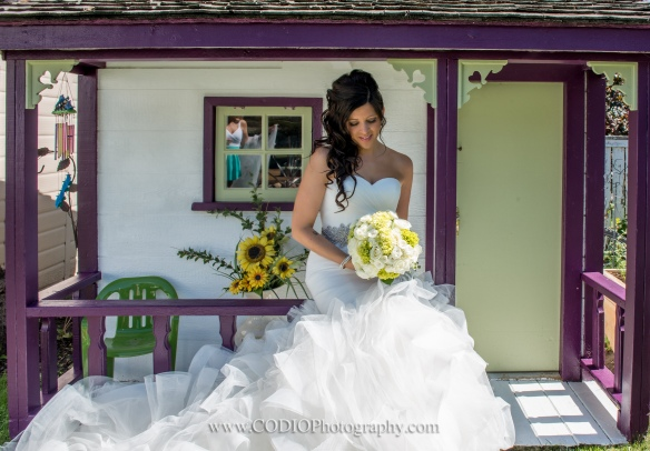 Bride with childhood playhouse